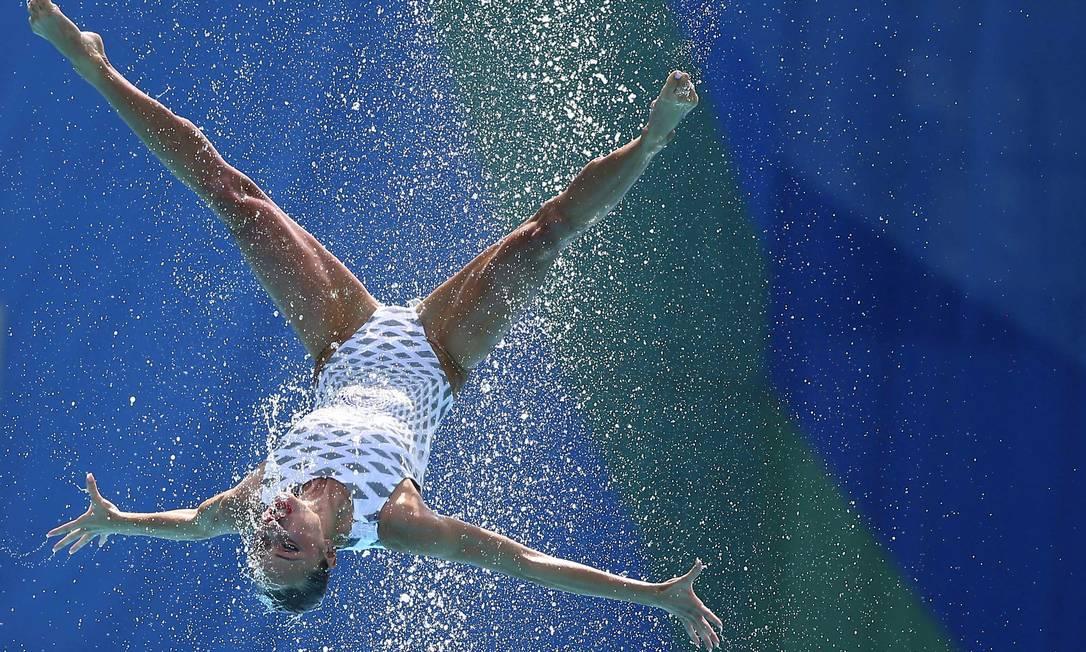 Equipe da Ucrânia se apresentando no nado sincronizado MICHAEL DALDER / REUTERS