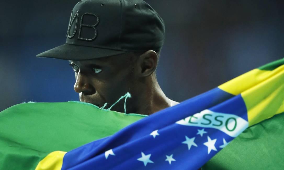 Ao sair das pistas para virar lenda, o jamaicano diz que sentirá falta do calor da torcida Jorge William / Agência O Globo