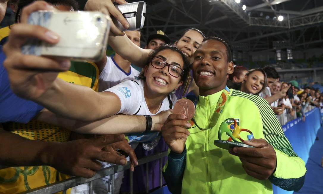 Festejado pela torcida, Maicon se tornou o segundo atleta brasileiro do taekwondo a subir ao pódio olímpico ISSEI KATO / REUTERS