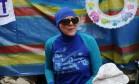 Manifestantes protestam, em frente à embaixada francesa em Londres, contra o veto a burquínis na França Foto: NEIL HALL / REUTERS