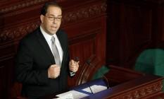 Youssef Chahed faz discurso frente ao Parlamento da Tunísia Foto: ZOUBEIR SOUISSI / REUTERS