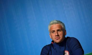 O nadador americano Ryan Lochte durante coletiva na Rio-2016 Foto: MARTIN BUREAU / AFP