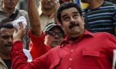 Apoio. Maduro durante ato em Caracas: governo convoca manifestação Foto: JUAN BARRETO / AFP/27-8-2016