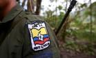 Membro das Forças Armadas Revolucionárias da Colômbia (Farc) em agosto de 2016 Foto: JOHN VIZCAINO / REUTERS