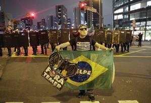 Manifestante protesta contra o presidente Michel Temer em São Paulo Foto: Andre Penner / AP / 02/09/2016