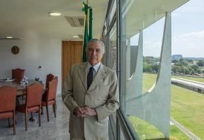 Temer disse que só pretende usar a faixa presidencial quando for entregá-la a seu sucessor Foto: André Coelho / Agência O Globo