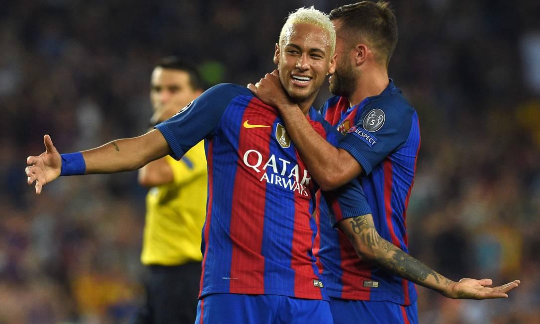 Neymar festeja seu gol nos 7 a 0 do Barcelona sobre o Celtic LLUIS GENE / AFP