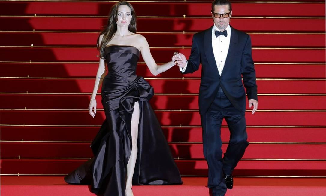 """Em Cannes 2011, a dupla parou o festival de cinema para promover """"A árvore da vida"""", em que ele atua com Sean Pean e Jessica Chastain YVES HERMAN / AFP"""