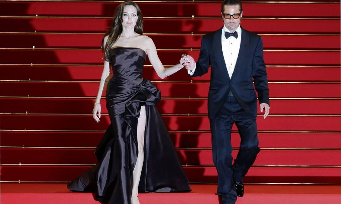 """Em Cannes 2011, a dupla parou o festival de cinema para promover """"A árvore da vida"""", em que ele atua com Sean Pean e Jessica Chastain Foto: YVES HERMAN / AFP"""