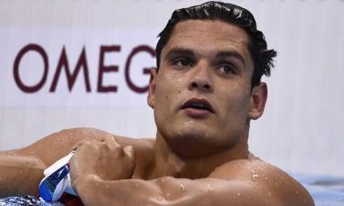 Florent Manaudou dará uma pausa na carreira nas piscinas para jogar handebol Foto: Christophe Simon / AFP