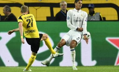 Schüerrle acerta uma bomba de esquerda, no fim, e garante o empate do Borussia com o Real Madrid, em Dortmund Foto: Martin Meissner / AP