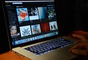 A tela do serviço de streaming Spotify Foto: Akio Kon / Bloomberg