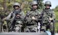 Militares reforçaram a segurança no Complexo da Maré, no Rio de Janeiro, durante as eleições de 2014: 25 mil militares farão a segurança em 408 municípios neste ano