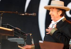 O cantor e compositor Bob Dylan em show em 2012 Foto: FRED TANNEAU / AFP
