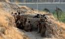 Forças curdas atuam logo após ataque do Estado Islâmicoo em Kirkuk, no Iraque Foto: AKO RASHEED / REUTERS