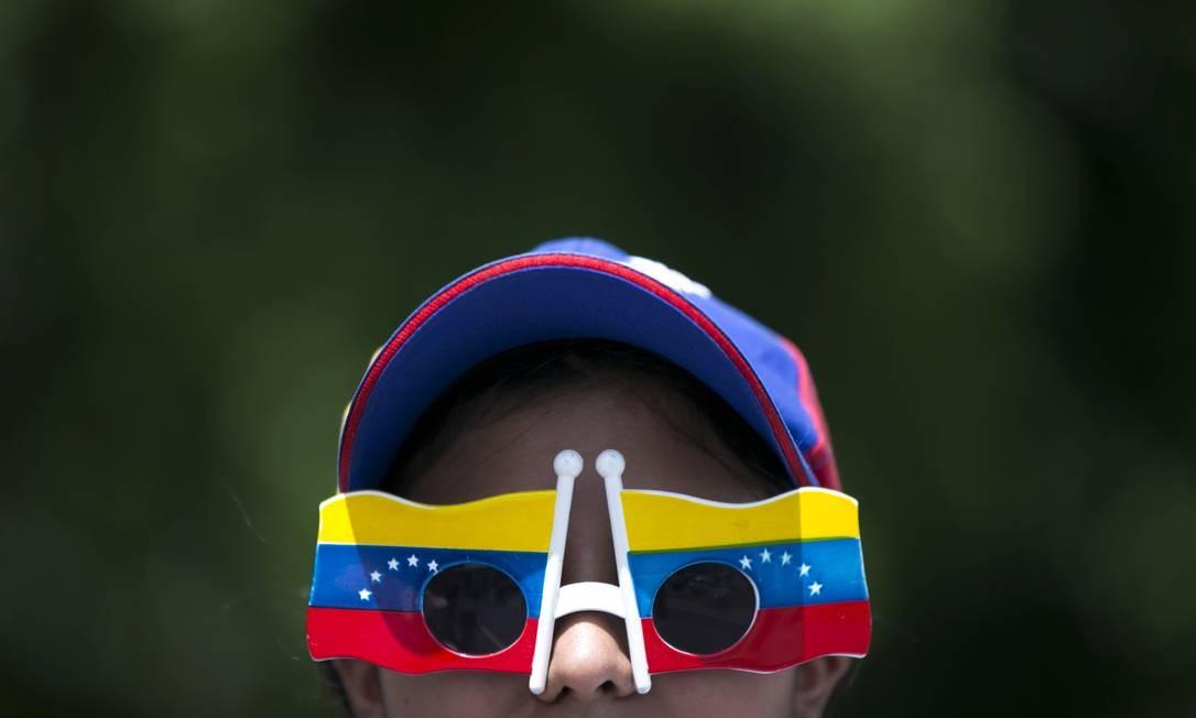 A marcha partiu às 10h de quatro pontos da capital: Parque Francisco de Miranda, Caurimare, Santa Fé e Jardim Botânico Foto: Ariana Cubillos / AP
