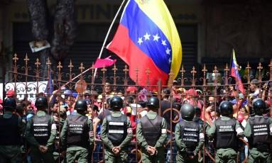 Opositores ao governo venezuelano protestam em Caracas Foto: RONALDO SCHEMIDT / AFP