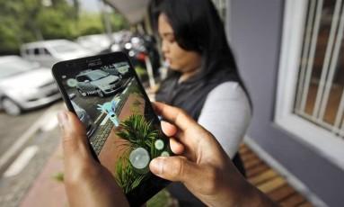 Jogo de realidade aumentada virou febre no mundo Foto: Achmad Ibrahim / AP / AP