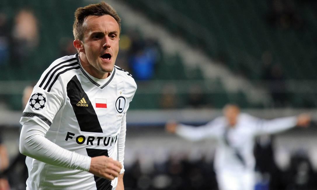 A alegria de Radovic após empatar para o Legia o jogo contra o Real Madrid Alik Keplicz / AP