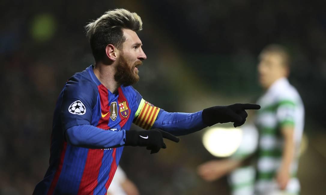 Messi comemora um de seus dois gols na vitória do Barcelona sobre o Celtic Scott Heppell / AP