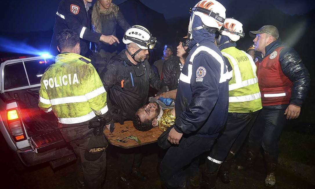Um dos sobreviventes do momento do resgate RAUL ARBOLEDA / AFP