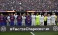 Em silêncio, jogadores prestaram sentimento ao clube catarinense Foto: Manu Fernandez / AP
