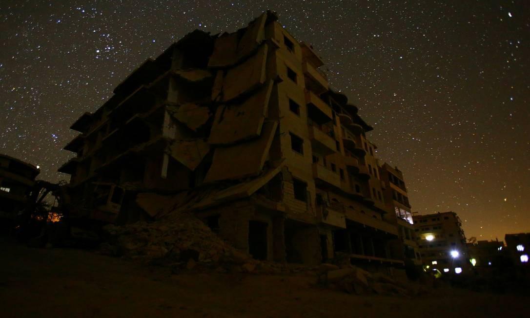 Prédios danificados na área de Maaret al-Numan, na província de Idlib, controlada por rebeldes Foto: Ammar Abdullah / REUTERS