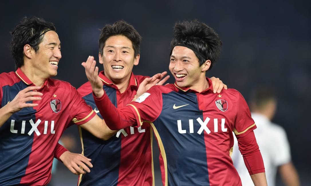 Festa dos jogadores do Kashima Antlers: time japonês ofereceu muito mais dificuldade ao Real Madrid do que se imaginava KAZUHIRO NOGI / AFP