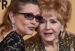 Carrie Fisher e Debbie Reynolds, em foto de 2015 Foto: ETHAN MILLER / AFP