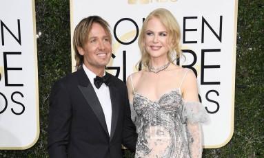 De Alexander McQueen, Nicole Kidman chegou acompanhada do marido, o cantor Keith Urban Foto: Frazer Harrison / AFP