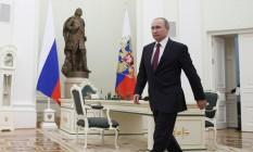 O presidente russo, Vladimir Putin, participa a uma reunião com seu homólogo moldavo Igor Dodon, no Kremlin, em Moscou Foto: POOL / REUTERS