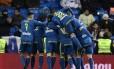 Jogadore do Celta de Vigo comemoram o segundo gol da vitória sobre o Real Madrid Foto: JAVIER SORIANO / AFP
