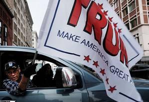 Felicidade republicana. Partidários de Trump celebram em Washington a chegada do bilionário ao poder hoje Foto: SPENCER PLATT / AFP