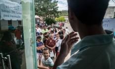 Fila de moradores para tomar a vacina da febre amarela em caratinga, cidade de Minas Gerais próxima do Espírito Santo Foto: Alexandre Rezende/Folhapress