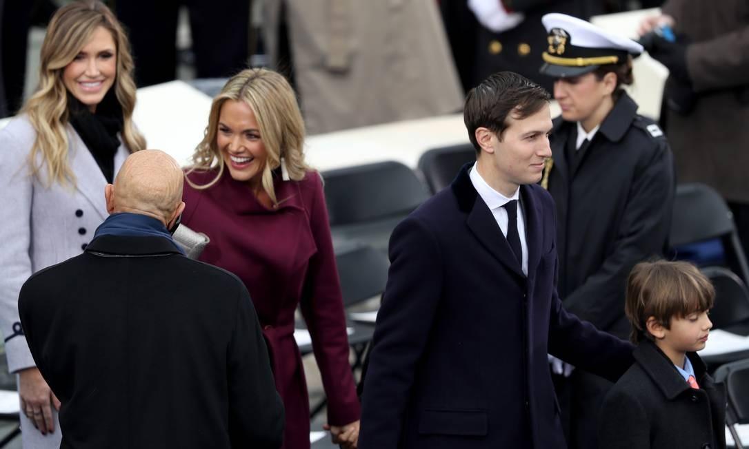 A família do magnata veio completa para a posse, com direito aos 'agregados': Lara, mulher de Eric Trump; Vanessa, cônjuge de Donald Jr.; e Jared Kushner, genro do presidente dos EUA, casado com sua filha Ivanka Foto: JOE RAEDLE / AFP