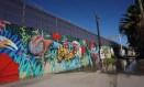 Muro em Tijuana, na fronteira entre México e EUA Foto: Sandy Huffaker / AFP