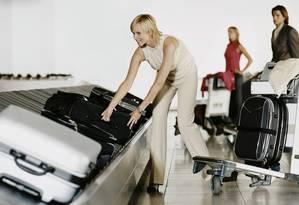 Bagagem. O custo do transporte ficará restrito a quem despachar, caso a regra seja mantida Foto: Divulgação / Digital Vision
