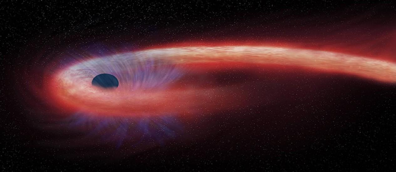 Ilustração mostra o que os astrônomos chamam de 'evento de disrupção por forças de maré', que acontece quando um objeto, como uma estrela, se aproxima demais de um buraco negro Foto: NASA/CXC/M.Weiss