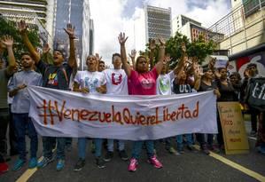 'Liberdade'. Marcha em Caracas em memória de jovens mortos há três anos Foto: ANEBERT RIVERA / AFP