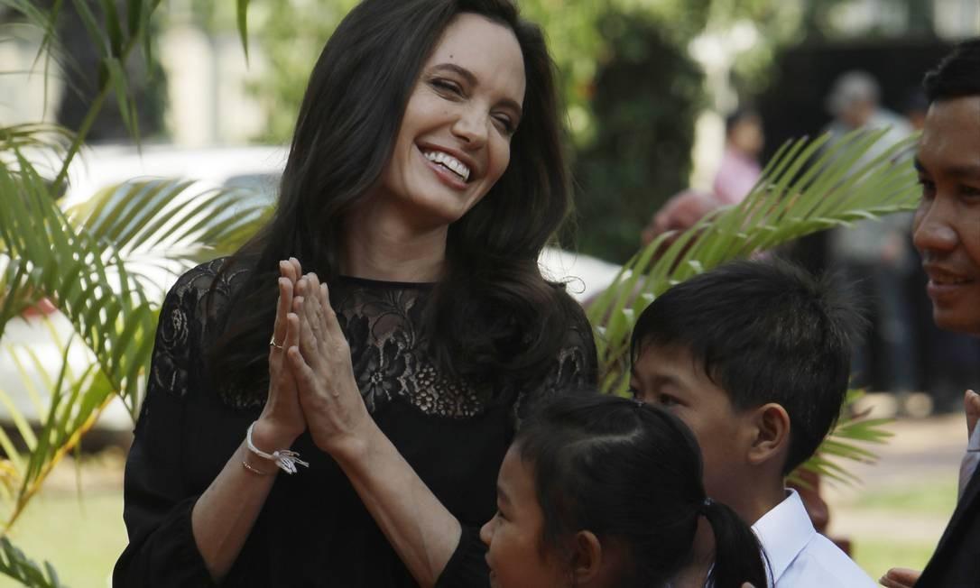 Maddox, que nasceu em Camboja, e Pax também estiveram envolvidos na produção do filme Foto: Heng Sinith / AP