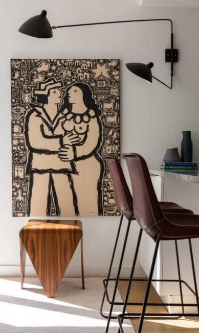 Na sala do mesmo apartamento em Nova York, a influência escandinava continuou, mas recebeu um charme brasileiro no décor Divulgação