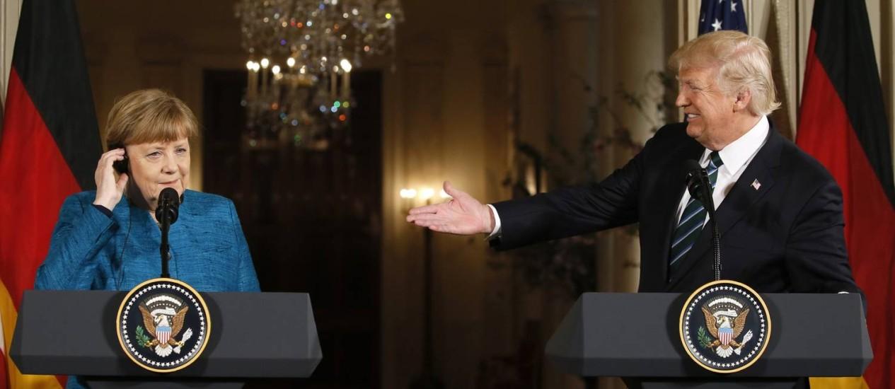 Merkel e Trump fazem coletiva de imprensa na Casa Branca Foto: JIM BOURG / REUTERS