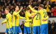 Jogadores da Suécia comemoram na vitória sobre a Bielorrússia pelas eliminatórias europeias Foto: JONATHAN NACKSTRAND / AFP