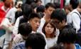 Chineses passeiam em Tóquio: discriminação preocupa governo japonês