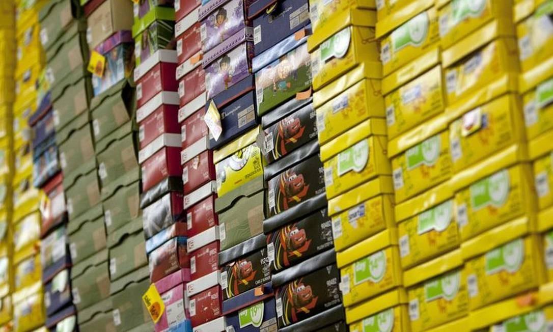 Caixas de sapato em uma filial da Payless, em Nova York Foto: / Scott Eells/Bloomberg/2-5-2012