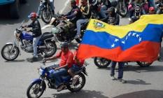 Apoiadores do presidente venezuelano, Nicolás Maduro, participam de manifestação pró-governo, em Caracas Foto: FEDERICO PARRA / AFP