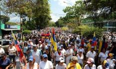 Oposição fez marcha silenciona neste sábado contra o governo do presidente venezuelano, Nicolás Maduro Foto: GEORGE CASTELLANOS / AFP