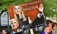 'Capanga do fascismo'. Manifestante alemão faz campanha contra a presença em Berlim de Ivanka Trump, conselheira do pai na Casa Branca: governo ganha aparência mais moderada Foto: JOHN MACDOUGALL / John MACDOUGALL/AFP