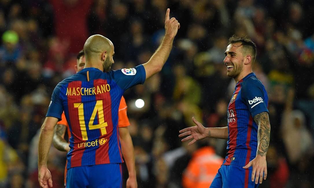 Mascherano comemora seu gol na vitória do Barcelona sobre o Osasuna Foto: LLUIS GENE / AFP