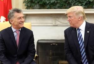 O Presidente dos EUA, Donald Trump, e o presidente da Argentina, Mauricio Macri, se reúnem no Salão Oval da Casa Branca, em Washington Foto: CARLOS BARRIA / REUTERS